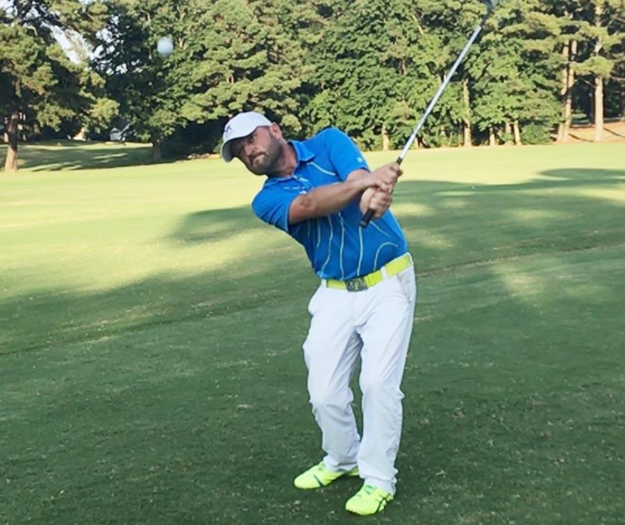 Tony Keeton teaches a golf lesson clients in Orlando